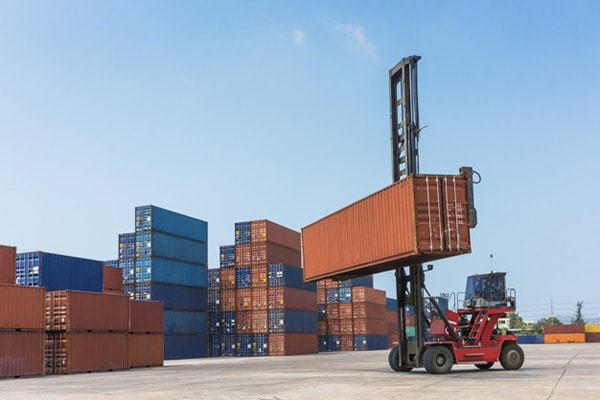 Forklift handling container box in Import, Export, Logistics are
